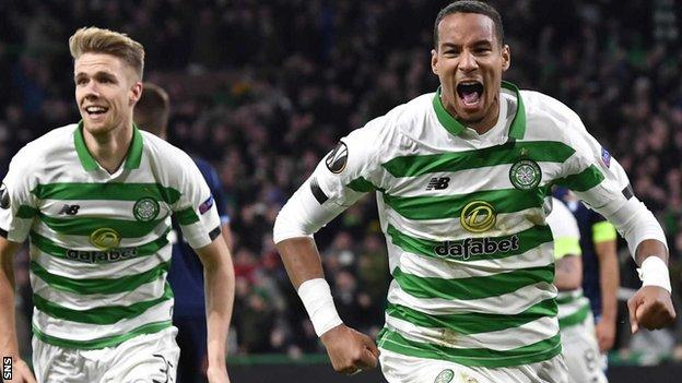 Christopher Jullien celebrates with Kristoffer Ajer (left) after he scores a late goal making it 2-1 during Celtic v Lazio at Celtic Park