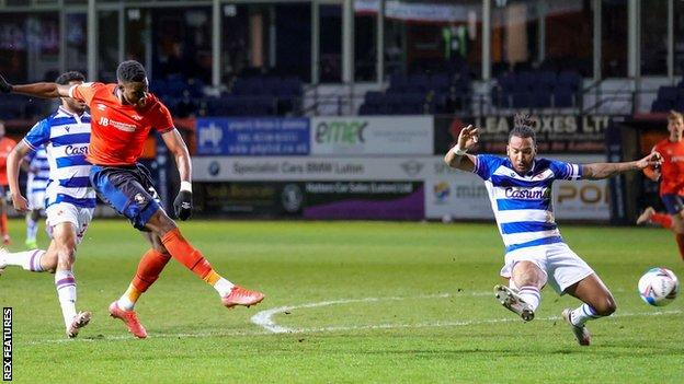 Elijah Adebayo goes close with a shot for Luton Town against Reading
