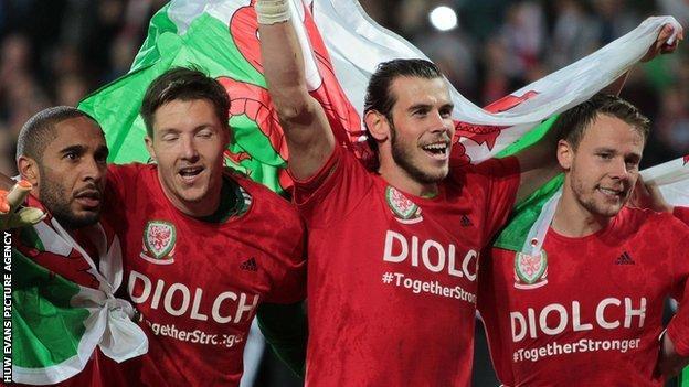 Ashley Williams (left), Wayne Hennessey, Gareth Bale and Chris Gunter celebrate Wales' Euro 2016 qualification