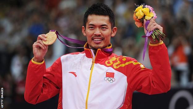 Lin Dan holds his London 2012 gold medal aloft