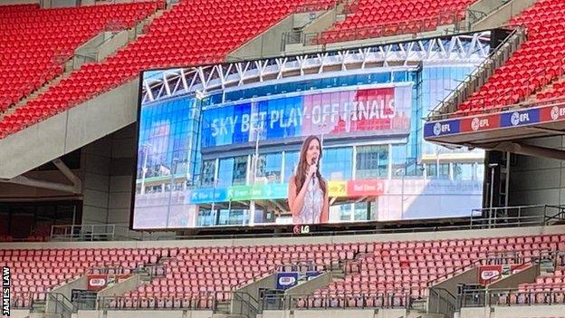 The national anthem is sung over Wembley's big screens
