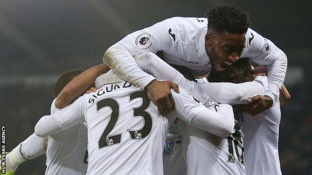 Swansea City celebrate a goal against Leicester City