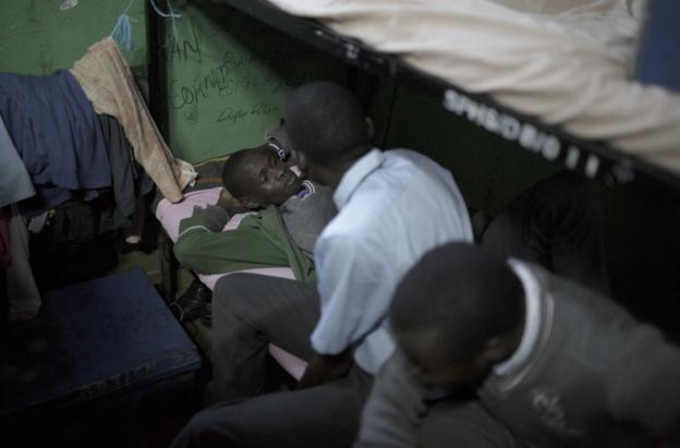 Cornelius Kemboi lying on his bunk bed at St Patrick's