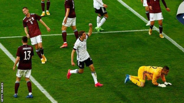 Thomas Muller celebrates after scoring