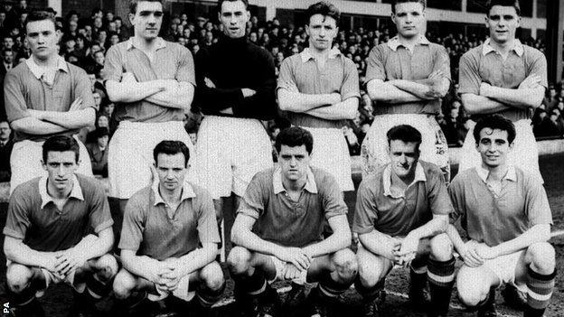 Manchester United in March 1957 - standing (left to right|) Eddie Colman (killed in Munich), Billy Foulkes, Ray Wood, Roger Byrne (killed in Munich), Mark Jones (killed in Munich), Duncan Edwards (killed in Munich). Squatting - Dennis Viollet, Johnny Berry, Tommy Taylor (killed in Munich), Billy Whelan (killed in Munich) and David Pegg (killed in Munich).