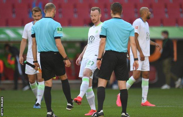 Wolfsburg players kicked boots with the officials afterwards