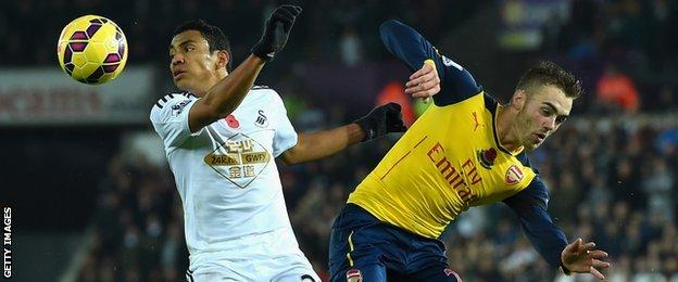 Jefferson Montero (left) takes on Arsenal's Calum Chambers during Swansea's 2-1 win in November 2014