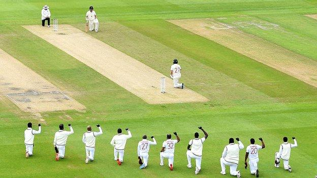 England and the West Indies take a knee before the start of a Test match