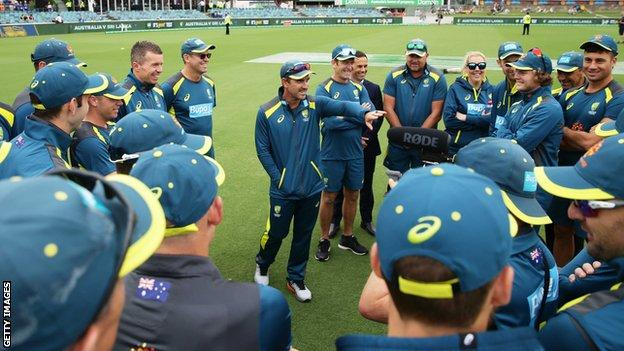 Australia coach Justin Lanager talks to his players