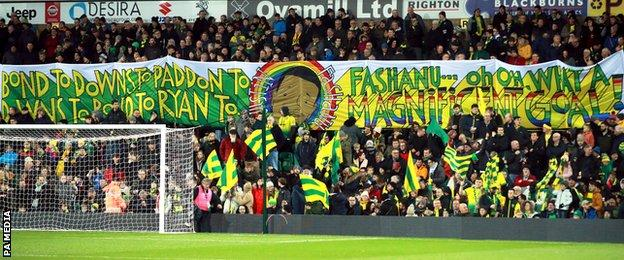 Norwich City fans raise a Justin Fashanu banner