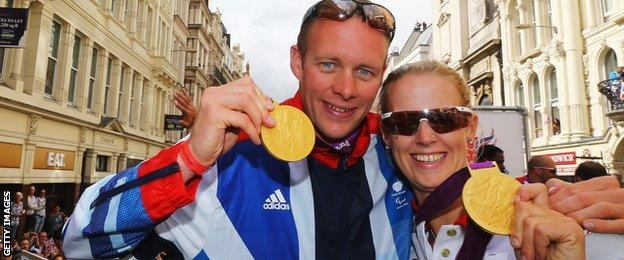 David Smith and Naomi Riches show off their London 2012 goald medals