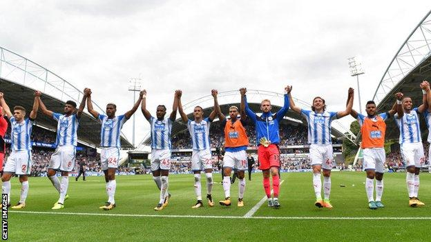 Huddersfield players celebrate after beating Newcastle