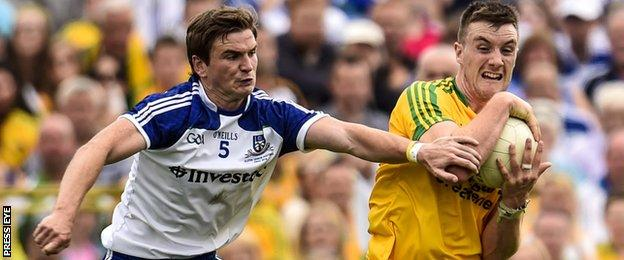 Leo McLoone battles with Monaghan's Dessie Mone in last year's Ulster Final
