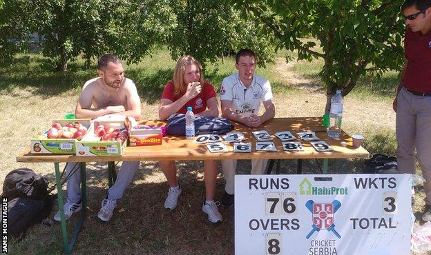 The scorers take shelter from the Balkan sun