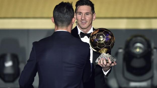 Cristiano Ronaldo shakes hands with Lionel Messi
