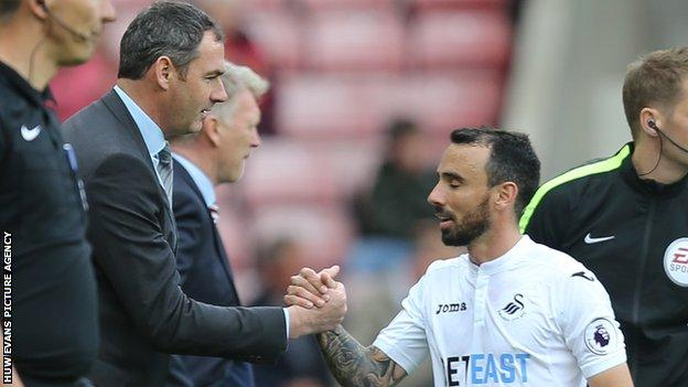 Paul Clement thanks Leon Britton for his efforts against Sunderland in May, 2017