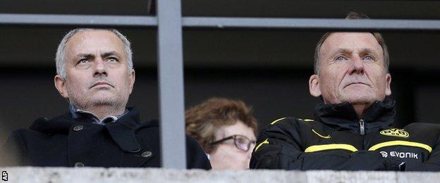 Jose Mourinho, left, and Dortmund president Hans-Joachim Watzke, right, attend the German Bundesliga soccer match between Hertha BSC Berlin and Borussia Dortmund in Berlin,