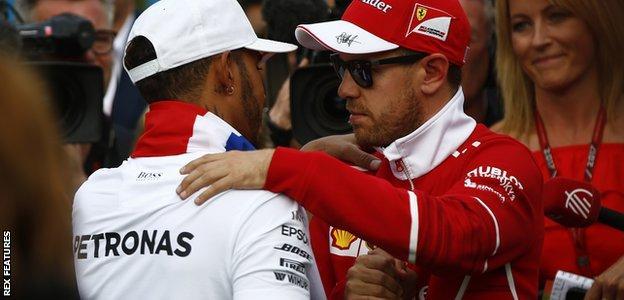 Sebastian Vettel congratulates Lewis Hamilton following his victory