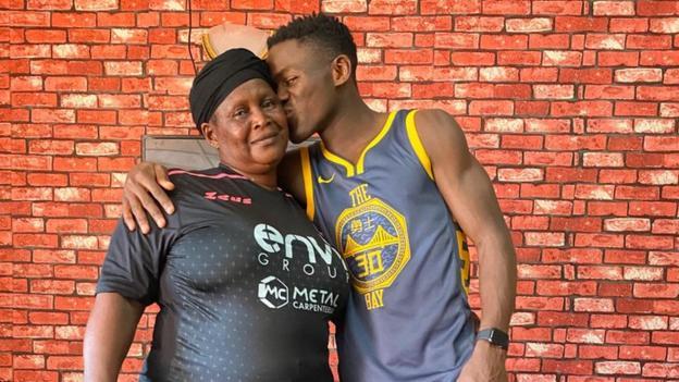 Augustus Kargbo kisses his mother Fatmata Kanu