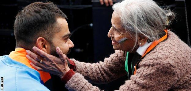 India captain Virat Kohli meets supporter Charu Latta Patel at the end of the match