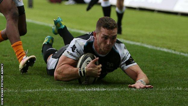 George North of Ospreys dives in to score a try