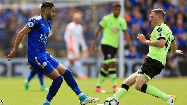 Dan Gosling of Bournemouth and Riyad Mahrez of Leicester
