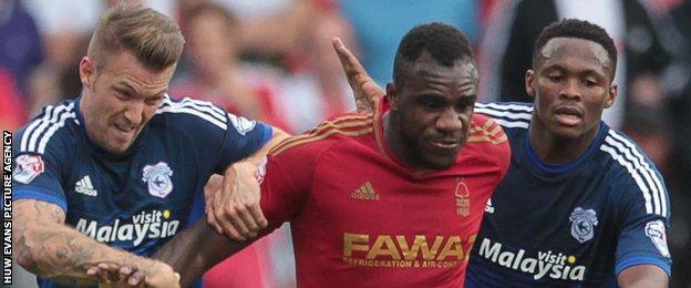 Forest goalscorer Michail Antonio battles past two Cardiff players