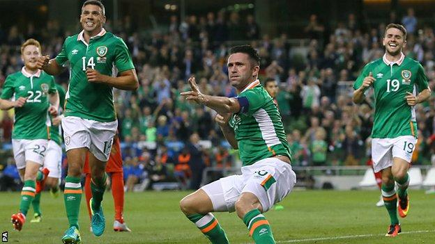 Robbie Keane gives Irish fans a final showing of his trademark celebration after netting against Oman