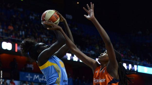South Sudan-born Adut Bulgak (left) jumps with the ball while playing for WNBA side Chicago Sky against Connecticut Sun's Jonquel Jones in 2016