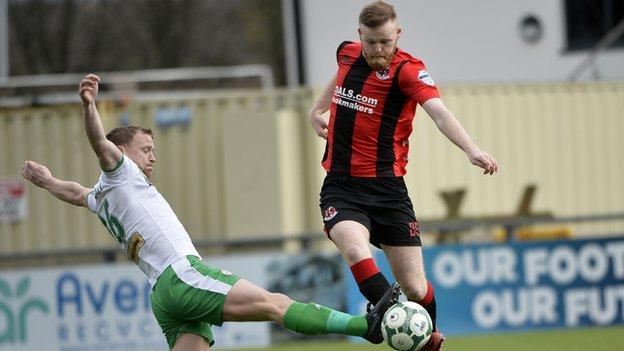 Cliftonville midfielder Liam Bagnall tackles Crues opponent Ross Clarke