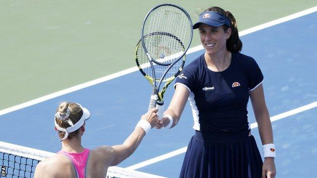 Johanna Konta taps racquets with Vera Zvonareva after their Western and Southern Open match
