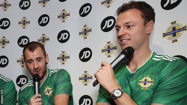 Niall McGinn and Jonny Evans