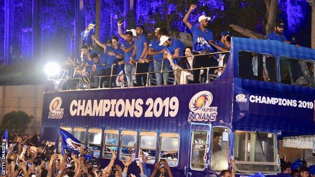 The Mumbai Indians team celebrate winning the 2019 IPL with an open-top bus parade in Mumbai
