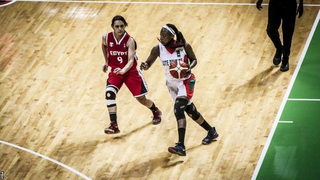 Mariama Kayoute dribbles basketball against Egypt