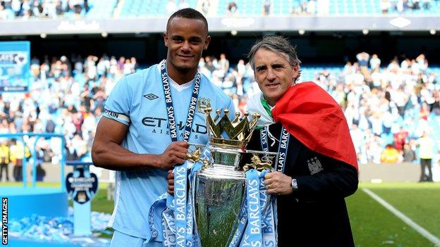 Vincent Kompany and Roberto Mancini lift the Premier League title in 2012