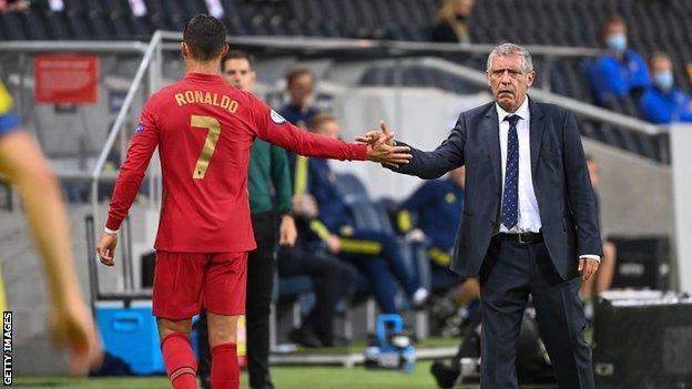 Fernando Santos and Cristiano Ronaldo tap hands