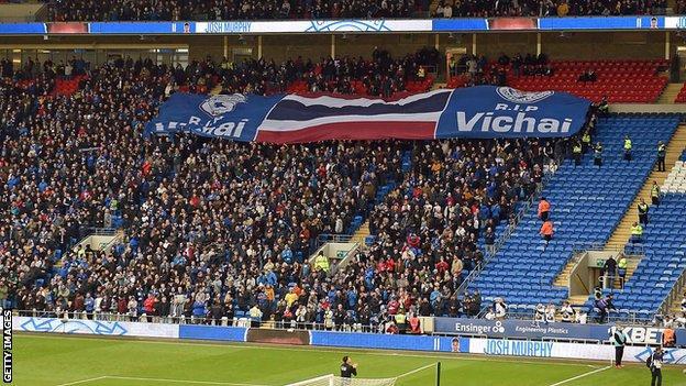 Cardiff fans hold aloft a banner