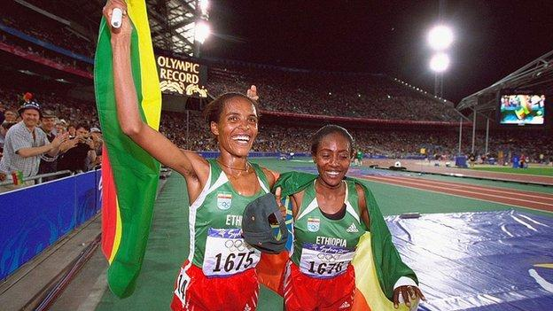 Derartu Tulu (left) celebrates breaking an Olympic Record after winning the women's 10,000m at the 2000 Olympic Games in Sydney.