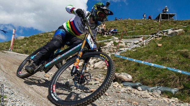 Danny Hart riding downhill at the UCI Mountain Bike World Cup.