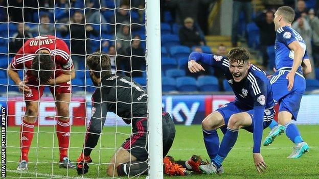 Joe Mason celebrates Cardiff City's winner from George Friend's own goal