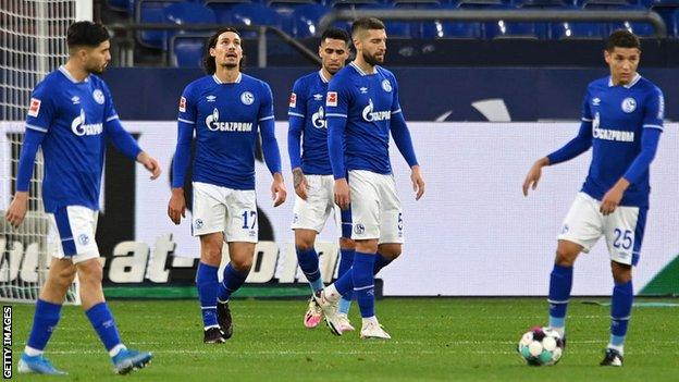 Dejected Schalke players after their team concede