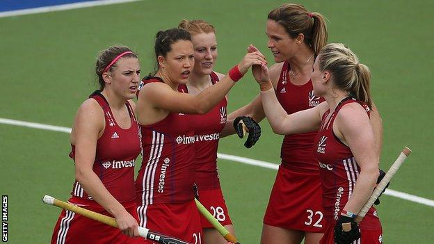 Great Britain team-mates congratulate Nicola White on the opening goal against South Korea