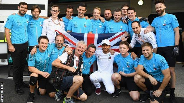 Lewis Hamilton celebrates his fifth world title with his Mercedes team