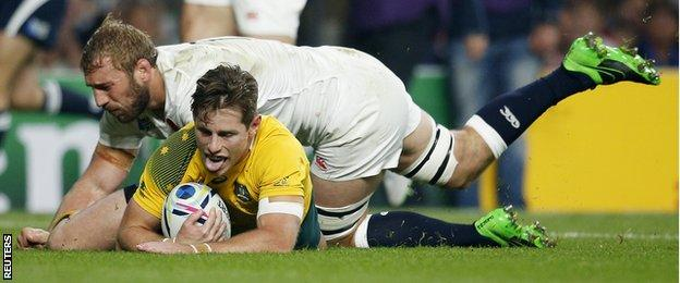 Bernard Foley scores for Australia despite the attentions of England captain Chris Robshaw