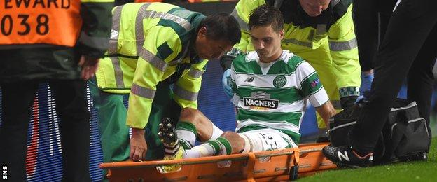 Celtic defender Mikael Lustig is stretchered off and may miss the return leg in Sweden