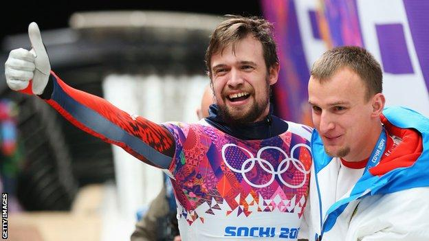 Russia's Alexander Tretiakov celebrates winning gold at Sochi