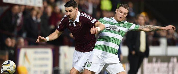 Hearts defender Calum Paterson tussles with Celtic striker Anthony Stokes