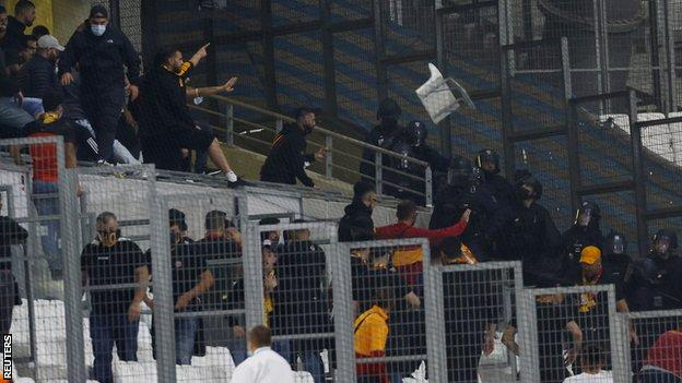 Galatasaray fans throw a chair towards Police