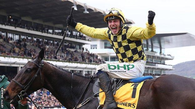 Paul Townend celebrates winning the Gold Cup on Al Boum Photo