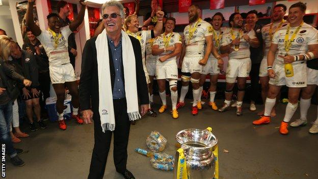 Nigel Wray in the Saracens dressing room with the Premiership trophy